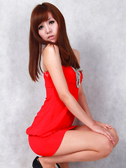 Sandy Asian on heels shows hot behind in red dress for pictures