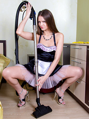 Gorgeous brunette maid with a big round ass teases her soft amateur pussy