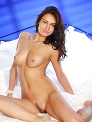 Yarina A can't wait to show off her tanned body in front of the camera. She just got back from a tropical vacation and her body looks amazing with her sun-kissed complexion. She starts taking off her matching lingerie, her lickable, firm assets are drool-