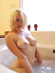 Girl next door gets naughty in her bath and rubs her shaved pussy