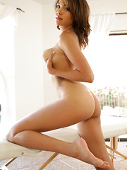 Busty Nubile tickles her throbbing clit with a magic wand