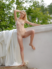 A big sheet of silk is what this girl has to cover her body, but you will be surprised how quick she loses it.