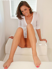 Tight Tori Black on the floor in her skimpy, white dress rubbing her dildo on her pussy