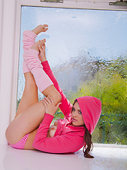 Stunning vixen Mila in her pink hoodie and socks showing off her luscious tits and wet pussy